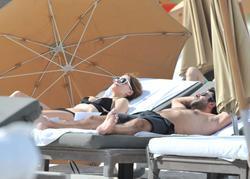 http://img131.imagevenue.com/loc482/th_312950977_P10O3N4Q1N_Mischa_Barton_Wearing_a_Bikini_in_Miami022_122_482lo.jpg