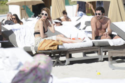 http://img131.imagevenue.com/loc486/th_312363775_Mischa_Barton_Bikini_Candids_on_the_Beach_in_Miami_December_27_2011_176_122_486lo.jpg