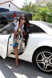 Audrina Patridge in shorts shows legs as she carrie clothes in Hollywood